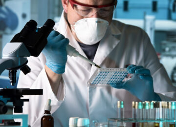 scientist working with microplate in a pharmaceutical lab / biomedical engineer working with samples in microplate in the laboratory